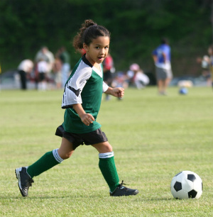 image of young girl playing soccer